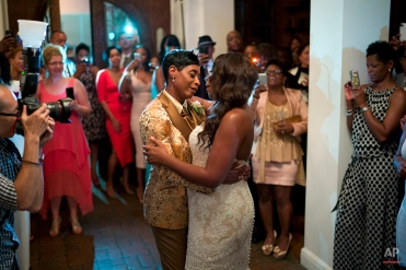 NBA referee Violet Palmer, center left, and her partner Tanya Stine dance during their wedding reception on Aug. 1, 2014, in Los Angeles. (AP Photo/Jae C. Hong)