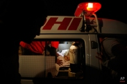 Hospital staff carry the body of Pakistani lawyer Samiullah Khan Afridi into an ambulance, in Peshawar, Pakistan, Tuesday, March 17, 2015. Unidentified gunmen shot and killed a former lawyer for the Pakistani doctor who helped the U.S. find Osama bin Laden. (AP Photo/Mohammad Sajjad)