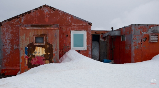 In this Jan. 24, 2015 photo, snow surrounds buildings used by Chile's scientists on Robert Island, part of the South Shetland Islands archipelago in Antarctica. Temperatures can range from above zero in the South Shetlands and Antarctic Peninsula to the unbearable frozen lands near the South Pole. (AP Photo/Natacha Pisarenko)