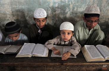 Pakistani Muslim students attend a religious madrassa, or school, to learn the Quran, in Karachi, Pakistan, Wednesday, March 4, 2015. Religious schools in Pakistan, most of them in mosques, are the only source of education for thousands of children. (AP Photo/Fareed Khan)