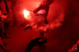 """In this Thursday, March 5, 2015 photo, a young man dances with flares during a local wedding in Salam City, a suburb on the outskirts of Cairo. Since the 2011 uprising, the music of """"Mahraganat,"""" Arabic for """"festivals,"""" has emerged from and spread through impoverished communities, where local musicians play, especially during weddings, their auto-tuned beats and songs that tackle social, political and cultural issues. (AP Photo/Mosa'ab Elshamy)"""