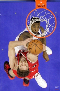 Philadelphia 76ers' Thomas Robinson, top, tries to block a shot by Chicago Bulls' Pau Gasol, of Spain, in the first half of an NBA basketball game, Wednesday, March 11, 2015, in Philadelphia. (AP Photo/Matt Slocum)