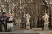 An elderly man and woman look at each other as they rest in front of the Royal Palace in Madrid, Spain, Thursday, Feb. 26, 2015. (AP Photo/Andres Kudacki)