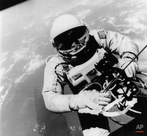 Air Force Lt. Col. Edward White II, who died at Cape Kennedy with fellow astronauts Air Force Lt. Col. Virgil I. Grissom and Navy Lt. Comdr. Roger B. Chaffee, is shown as he clambered from the Gemini 4 spacecraft to become the first American to walk in space. The space walk came during his 1965 flight with James McDivitt. (AP Photo)