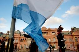 Soldiers of the Granaderos de San Martin regiment fold the Argentina's flag at the Plaza de Mayo square in Buenos Aires, Argentina, Friday, Feb. 20, 2015. (AP Photo/Rodrigo Abd)