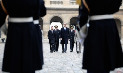 French prime minister Manuerl valls, left, and Spain's King Felipe VI, right, salute the flag during a welcoming ceremony at the Invalides in Paris, Tuesday, March 24, 2015. The Spanish Royal Couple arrived Tuesday for a three-day official visit in France. (AP Photo/Remy de la Mauviniere/Pool)