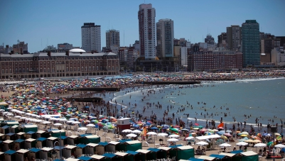 People spend time at the beach in Mar del Plata, Argentina, Wednesday, Jan. 9, 2013. Mar del Plata is a popular summer vacation spot for Argentines. (AP Photo/Natacha Pisarenko)