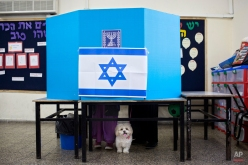 Israelis prepares to vote in Tel Aviv, Israel, Tuesday, March 17, 2015. Israelis are voting in early parliament elections following a campaign focused on economic issues such as the high cost of living, rather than fears of a nuclear Iran or the Israeli-Arab conflict. (AP Photo/Oded Balilty)