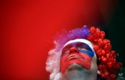 A Russian fan watches the finals during the men's two-man bobsled competition at the 2014 Winter Olympics, Feb. 17, 2014, in Krasnaya Polyana, Russia. (AP Photo/Jae C. Hong)