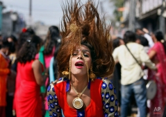 A eunuch dances during a rally to mark the congregation of thousands of eunuchs from different parts of India, in Jammu, India, Friday, March 13, 2015. The term eunuchs is used in India to describe transvestites, transsexuals and others who identify themselves as neither male nor female but as a member of a third gender. They traditionally survive by begging, dancing at weddings or blessing newborn babies and are frequently subjected to discrimination. (AP Photo/Channi Anand)