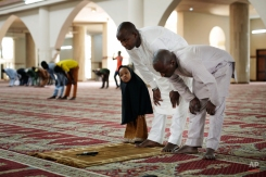 Nigerians bow in the main mosque during Friday prayers, in the capital Abuja, Nigeria, Friday, March 27, 2015. Nigerians are due to go to the polls to vote in presidential elections on Saturday. (AP Photo/Jerome Delay)