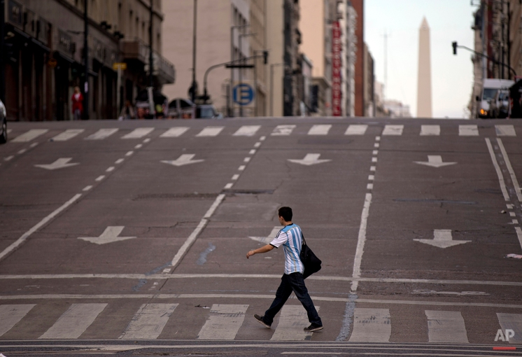 A man crosses an avenue during a transportation strike in Buenos Aires, Argentina, Tuesday, March 31, 2015. (AP Photo/Natacha Pisarenko)