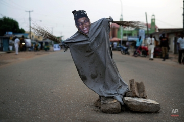 A puppet showing Governorial candidate Nasir Ahmad El Rufai is set in the street in Kaduna, Nigeria, Monday, March 30, 2015. Nigerians are waiting in hope and fear for results of the tightest and most bitterly contested presidential election in the nation's turbulent history. (AP Photo/Jerome Delay)