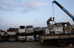 New Suzuki vehicles, destroyed by tsunami waters from the March 11 massive earthquake, are piled on the Suzuki company lot, in Sendai, Miyagi prefecture, Japan on Tuesday, March 29, 2011. (AP Photo/Wally Santana)