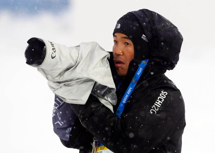 Jae Hong is seen during men's ski half pipe qualifying at the Rosa Khutor Extreme Park, at the 2014 Winter Olympics, Tuesday, Feb. 18, 2014, in Krasnaya Polyana, Russia. (AP Photo/Sergei Grits)