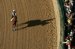 Exercise rider Dana Barnes rides Kentucky Derby hopeful Dortmund during a workout at Churchill Downs Wednesday, April 29, 2015, in Louisville, Ky. (AP Photo/Charlie Riedel)