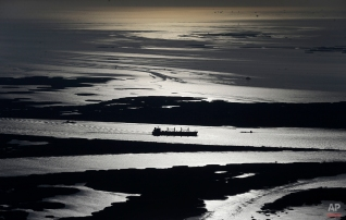 A cargo ship plies up the Mississippi River towards New Orleans in Plaquemines Parish, La., March 31, 2015. (AP Photo/Gerald Herbert)