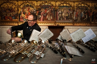 A musician prepares his musical score beside trumpets and clarinets during a Sunday Mass of ''Descent of the Angel'', in the small town of Tudela, northern Spain, April 5, 2015. (AP Photo/Alvaro Barrientos)