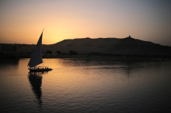 A pleasure boat carrying tourists and locals sails in the Nile River at sunset in Aswan, Egypt, Wednesday, April 29, 2015. (AP Photo/Mosa'ab Elshamy)