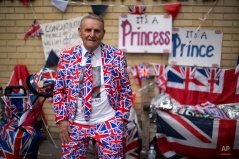 Royal fan Terry Hutt, aged 79, with his Union flag designed outfit, flags and signs stands across the street from the Lindo Wing of St. Mary's Hospital in London, Thursday, April 23, 2015. Britain's Kate the Duchess of Cambridge is expected to give birth to her second child with her husband Prince William at the hospital in the coming days or weeks. A small number of dedicated royal fans are waiting or camping outside the hospital awaiting the imminent birth. (AP Photo/Matt Dunham)