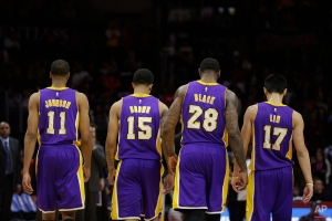 Los Angeles Lakers' Wesley Johnson, from left, Jabari Brown, Tarik Black, Jeremy Lin walk off the court for a timeout during the second half of an NBA basketball game against the Los Angeles Clippers, Tuesday, April 7, 2015, in Los Angeles. The Clippers won 105-100. (AP Photo/Jae C. Hong)