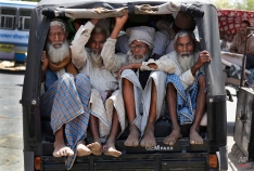 Indian Muslim devotees travel in an auto rickshaw during the Urs festival in Ajmer, India, Thursday, April 23, 2015. Thousands of devotees from different parts of India travel to the shrine of Sufi saint Khwaja Moinuddin Chisht for the annual festival marking the saint's death anniversary. (AP Photo/Deepak Sharma)