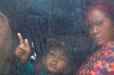 A Nepalese woman and her child leave Kathmandu for their home town by bus after a recent earthquake, in Kathmandu, Nepal, Thursday, April 30, 2015. The 7.8-magnitude earthquake shook Nepal's capital and the densely populated Kathmandu valley on Saturday, devastating the region and leaving tens of thousands shell-shocked and sleeping in streets. (AP Photo/Manish Swarup)