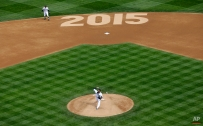 Seattle Mariners starting pitcher Felix Hernandez throws the first pitch of the first inning of an opening day baseball game against the Los Angeles Angels, Monday, April 6, 2015, in Seattle. (AP Photo/Ted S. Warren)