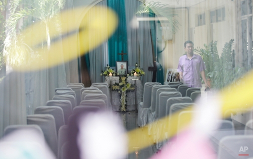"""A coffin of Brazilian death row convict Rodrigo Gularte is placed inside a funeral home in Jakarta, Indonesia Thursday, April 30, 2015. Indonesia brushed aside last-minute appeals and executed eight people including Gularte convicted of drug smuggling on Wednesday, although a Filipino woman was granted a stay of execution. Brazil's President Dilma Rousseff said in a statement the execution of a second Brazilian citizen in Indonesia this year """"marks a serious event in the relations between the two countries."""" Brazil had asked for a stay of execution for Gularte, 42, on humanitarian grounds because he was schizophrenic. (AP Photo/Achmad Ibrahim)"""