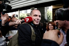 Greece's Finance Minister Yanis Varoufakis is surrounded by protesters and media workers as he arrives at the Finance ministry in Athens, Greece, Thursday, April 30, 2015. Varoufakis has indicated his country's left-wing government could make concessions on key demands by bailout lenders over the summer after a deal is reached to unlock remaining rescue funds. (AP Photo/Yorgos Karahalis)