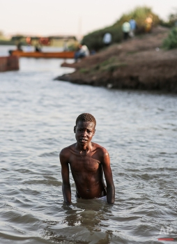 A Sudanese boys poses for a photograph while swimming in the Nile River, in Khartoum, Sudan, April 14, 2015. (AP Photo/Mosa'ab Elshamy)