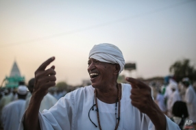 An adherent of the Qadiriyah Sufi order attends a weekly gathering at the tomb of Sheikh Hamed Al Nil, a 19th century Sufi leader, where they dance and chant religious hymns until nightfall, in Omdurman, Sudan, April 10, 2015. (AP Photo/Mosa'ab Elshamy)