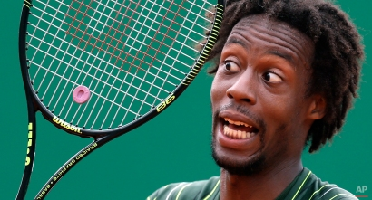 Gael Monfils of France reacts during his match of the Monte Carlo Tennis Masters tournament against Roger Federer of Switzerland, in Monaco, Thursday, April 16, 2015. (AP Photo/Lionel Cironneau)
