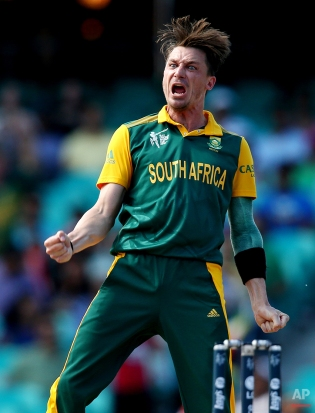 South African bowler Dale Steyn celebrates after taking the wicket of Sri Lanka's Tillakaratne Dilshan during their Cricket World Cup quarterfinal match in Sydney, Australia, Wednesday, March 18, 2015. (AP Photo/Rick Rycroft)