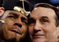 Duke's Quinn Cook and head coach Mike Krzyzewski celebrate their 68-63 victory with the championship trophy over Wisconsin in the NCAA Final Four college basketball tournament championship game Monday, April 6, 2015, in Indianapolis. (AP Photo/David J. Phillip)
