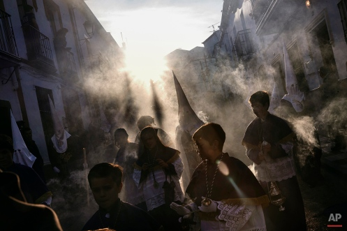 In this photo taken on Thursday, April 2, 2015, penitents take part on the 'Estacion Penitencial de Nuestro Padre Jesus Nazareno Cautivo' Holy Week procession in Arriate, Spain. (AP Photo/Daniel Ochoa de Olza)