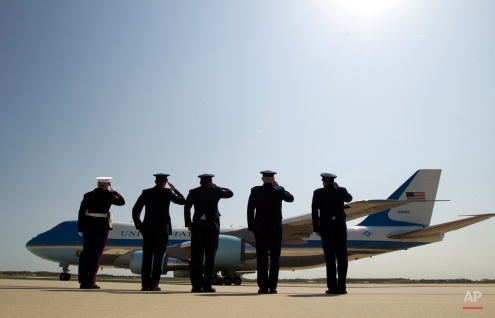 """Military personnel salutes as Air Force One, with President Barack Obama aboard, departs from Andrews Air Force Base in Md., Wednesday, April 22, 2015. Obama is celebrating Earth Day with a visit to the Everglades to talk about how global warming threatens the U.S. economy. He says rising sea levels are putting the """"economic engine for the South Florida tourism industry"""" at risk. (AP Photo/Jose Luis Magana)"""