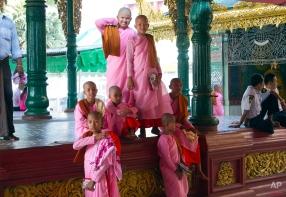 Myanmar Buddhist nuns gather as they visit Shwedagon Pagoda, April 8, 2015, in Yangon, Myanmar. (AP Photo/Khin Maung Win)