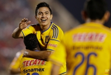 Dieter Villalpando of Mexico's Tigres, celebrates with his teammates after scoring against Peru's Juan Aurich during a Copa Libertadores soccer match in Chiclayo, Peru, Wednesday, April 15, 2015. (AP Photo/Martin Mejia)