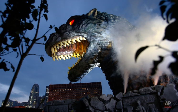 Godzilla's head is unveiled as the irradiated monster was appointed special resident and tourism ambassador for Tokyo's Shinjuku ward during its awards ceremony in Tokyo, Thursday, April 9, 2015. The giant Godzilla head towering 52-meters (171 feet) above ground level was unveiled Thursday at an office of Toho, the studio behind the 1954 original. (AP Photo/Shizuo Kambayashi)
