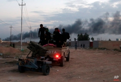 Iraqi security forces prepare to attack Islamic State extremist positions during clashes in Tikrit, 130 kilometers (80 miles) north of Baghdad, Iraq, Saturday, March 28, 2015. (AP Photo/Khalid Mohammed)