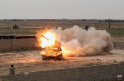 Iraqi security forces launch rockets against Islamic State extremist positions in Tikrit, 130 kilometers (80 miles) north of Baghdad, Iraq, Saturday, March 28, 2015. (AP Photo/Khalid Mohammed)