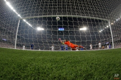 Juventus' Alvaro Morata, center rear, scores 1-1 passing Real Madrid's goalkeeper Iker Casillas during the Champions League second leg semifinal soccer match between Real Madrid and Juventus, at the Santiago Bernabeu stadium in Madrid, Wednesday, May 13, 2015. The match ended in a 1-1 draw, Juventus won on aggregate and will play Barcelona in the Champions League final on June 6, 2015 in Berlin. (AP Photo/Daniel Ochoa de Olza)