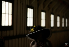 A race fan walks in the concourse before the 140th Preakness Stakes horse race at Pimlico Race Course, Saturday, May 16, 2015, in Baltimore. (AP Photo/Matt Slocum)
