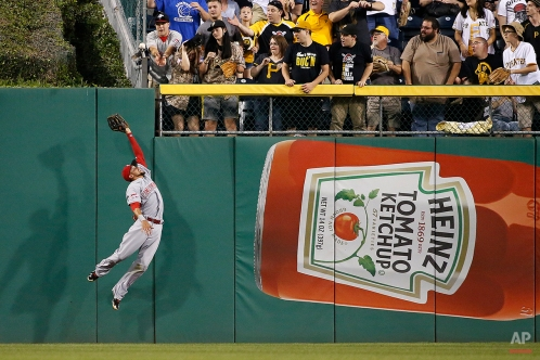 Cincinnati Reds center fielder Billy Hamilton can't come down with the ball off the center field wall by Pittsburgh Pirates' Pedro Alvarez in the fifth inning of a baseball game Thursday, May 7, 2015, in Pittsburgh. A run was scored on the Alvarez double off Cincinnati Reds starting pitcher Anthony DeSclafani. (AP Photo/Gene J. Puskar)