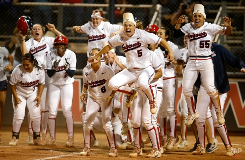 Arizona celebrates after Chelsea Goodacre ties the game in the bottom of the seventh inning with a two-run home run against Minnesota during an NCAA college softball tournament regional championship game, Sunday, May 17, 2015, in Tucson, Ariz. (AP Photo/Rick Scuteri)