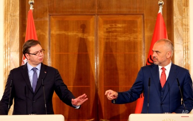 Albanian Prime Minister Edi Rama, right, gestures during a news conference with Serbian Prime Minister Aleksandar Vucic, the first Serbian leader to visit the nation after a troubled past, at the Palace of Brigades, Tirana, Albania, Wednesday, May 27, 2015. Both countries are trying to overcome their troubled past while working toward EU membership. Relations between the two Balkan states remain strained, mainly over the former Serbian province of Kosovo where majority ethnic Albanians declared independence in 2008 which Serbia refused to recognize. (AP Photo/Hektor Pustina)