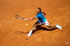 Rafael Nadal, of Spain, returns the ball to Marsel Ilhan, of Turkey, during their match at the Italian Open tennis tournament, in Rome, Wednesday, May 13, 2015. (AP Photo/Andrew Medichini)