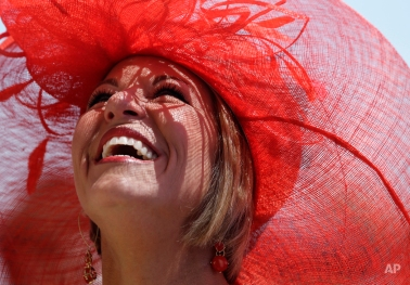 Sara Ward looks up before the 141st running of the Kentucky Oaks horse race at Churchill Downs Friday, May 1, 2015, in Louisville, Ky. (AP Photo/Darron Cummings)