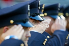 Washington DC firefighters salute during a moment of silence for Lt. Kevin McRae, who recently died in the line of duty, before a baseball game between the Washington Nationals and the Atlanta Braves at Nationals Park, Friday, May 8, 2015, in Washington. (AP Photo/Alex Brandon)